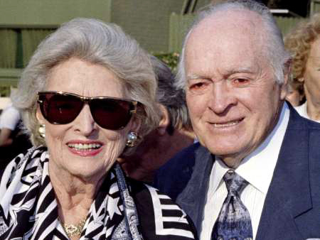 Bob Hope (R) and wife Dolores are pictured at the Hollywood Bowl, Los Angeles, June 30, 1996 (Credit: Reuters/Fred Prouser)