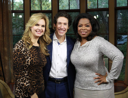 Joel Olsteen and his wife pose for a photo with Oprah Winfrey sometime during their interview with Oprah (Courtesy of Harpo Studios/George Burns)