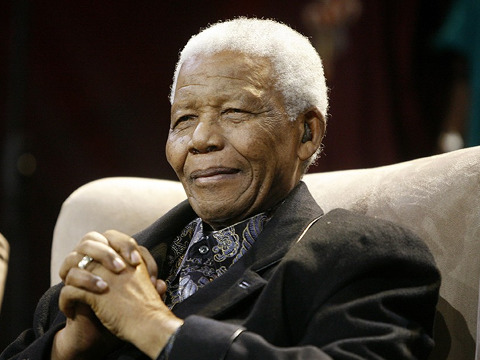 Nelson Mandela listens to the State of The Nation address being delivered by the current President Jacob Zuma at Parliament in Cape Town, June 3, 2009 (Credit: Reuters/Mike Hutchings)