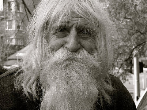 Dobri Dimitrov Dobrev, born 20 July 1914, better known as Grandpa Dobri, Elder Dobri, or The Saint of Bailovo, a Bulgarian ascetic who walks several kilometers each day to sit or stand in front of the Cathedral of Alexander Nevsky in Sofia to collect money for charitable causes pauses for a photo (Credit: Unknown)