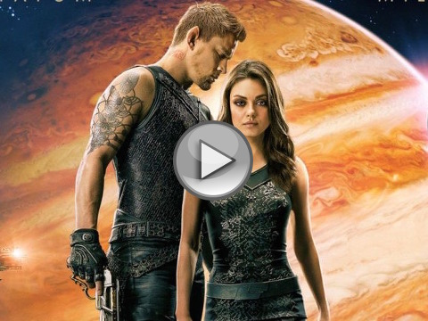 Mila Kunis as down-on-her-luck cleaning woman Jupiter Jones and Channing Tatum as Caine Wise, an interplanetary warrior, standing together with the planet Jupiter in the background from the official theatrical poster for the space opera movie from Warner Brothers (Credit: Warner Brothers Pictures)