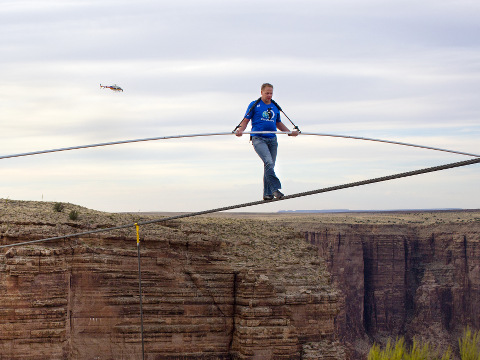 Nik Wallenda nears the completion of his 1400 foot walk across the Grand Canyon for Discovery Channel's Skywire Live With Nik Wallenda, Grand Canyon, California, June 23, 2013 (Credit: AP Images/Tiffany Brown)