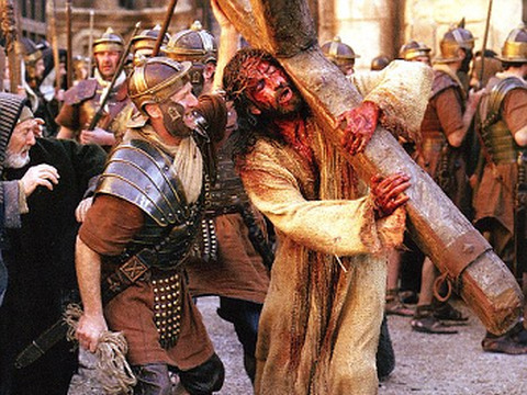 'The Passion of the Christ' with Jesus potrayed by Jim Caviezel being mocked by a Roman soldier while carrying the cross (Icon Pictures)